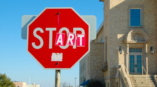 Vandalized_stop_sign_-_start_and_stop